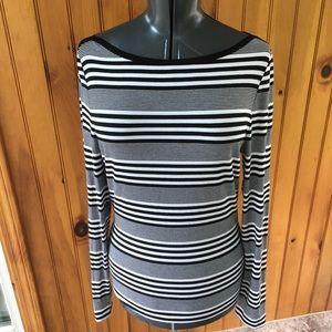 Joan Vas's medium black striped boat neck shirt